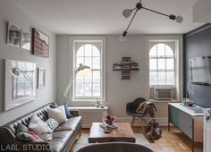 Sofa Sleeper A prewar West Village NYC bachelor pad apartment with masculine living room featuring a gallery wall