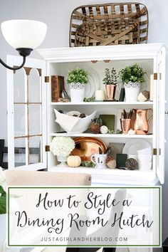 Love the beautifully styling of this dining room hutch-- she gives awesome styling tips too! | JustAGirlAndHerBlog.com