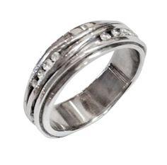 Platinum and diamonds wave ring.