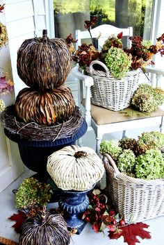 Make a pumpkin topiary from woven pumpkins and add a wreath to give it some height!  Love all these ideas!