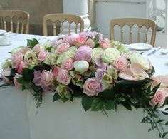 """Wedding Flowers """"A dreamy arrangement of pink and cream peonies, perfect pink and cream roses orchids and exotic anthurium interspersed with glossy foliage and soft fern to create a romantic arrangement for the top table at the reception."""""""