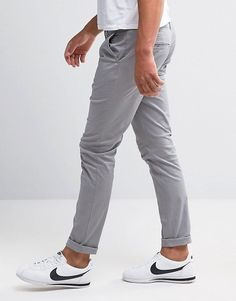 Buy ASOS DESIGN skinny chinos in light grey at ASOS. Get the latest trends with ASOS now. Grey Chinos, Skinny Chinos, Grey Pants, Men's Chinos, Mens Dress Pants, Men Dress, Tartan Men, Celebrity Travel, Dress With Boots