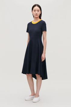 Model front image of Cos panelled jersey dress in blue