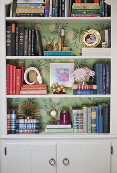 wallpapered shelves.