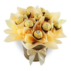 Ferrero Bouquet Ferrero Bouquet consists of 10 Ferrero Rocher chocolates in a sweet tin finished with colourful bow.