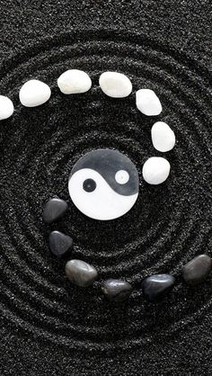 Yin Yang  & stones with design in sand art