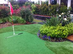 Synthetic turf putting green. Perfect for a range of homes... and don't forget to come over to the Lifestyle Solutions Centre and have a putt.