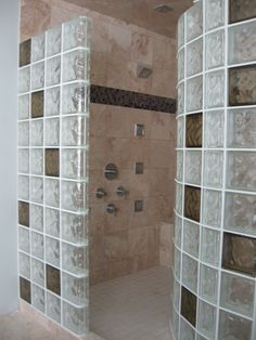 Another custom look using colored glass block coordinated with ceramic tile. Contact Masonry & Glass Systems in St. Louis. They specialize in all glass blocks and can ship all across the United States. For more information on glass block showers please check out their glass block shower pages at http://www.masonryglass.com or call 314-535-6515