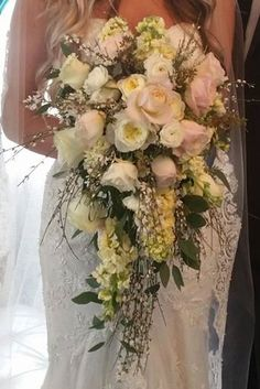 Gorgeous cascade bouquet of Ivory and Blush.  Sweet Peas Floral Vancouver. WA.