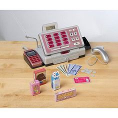 Just Like Home Talking Cash Register by Toys R Us, http://www.amazon.com/dp/B005WJ00IQ/ref=cm_sw_r_pi_dp_bHKyqb1WYFEQN