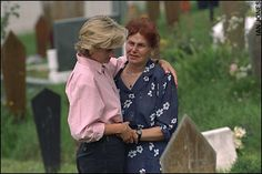 August 10, 1997: Diana, Princess of Wales comforts the relative of a person killed by a landmine in Sarajevo, Bosnia.