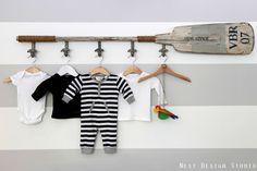We love clever ways to display sweet baby clothes in the nursery.