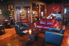 If I get a craft room & a wine cellar in our house then Tyler definitely gets a cigar room! Outfitted with dark wood, red/brown leather chairs, and palm tree ceiling fans. He'd be a happy man Bar Lounge, Office Lounge, Lounge Ideas, Whiskey Lounge, Brown Leather Chairs, Cigar Room, Relaxation Room, Man Room, Lounge Furniture