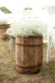 Use barrels to hold bouquets of baby's breath. Adorable and cheap wedding reception decor! #country #Wedding