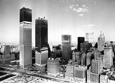 The World Trade Center towers nearing completion in the early 1970s.  Source: The New York Times file photo