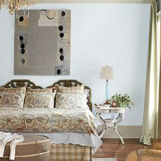 The bed linens, a modern floral duvet paired with a checked bed skirt and shams, are sweet but not too feminine. | SouthernLiving.com