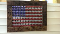 Beer bottle cap flag.  Thank you Anheuser-Busch.  Made from Bud, Bud Light, and Michelob Ultra caps.  This piece is for sale!