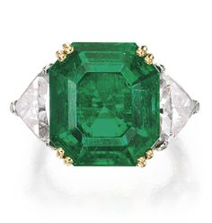 Platinum, 18 Karat Gold, Emerald and Diamond Ring, David Webb -  Centered by a square emerald-cut emerald weighing 11.20 carats, flanked by triangular-shaped diamonds weighing 3.79 carats