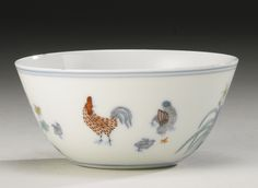 A MING-STYLE DOUCAI 'CHICKEN' CUP QING DYNASTY, KANGXI PERIOD with deeply rounded sides rising to a slightly everted rim, the exterior painted with chicken and chicks separated by blue rocks amidst flowers, all between blue borders, apocryphal six-character Chenghua mark in underglaze blue within a double square