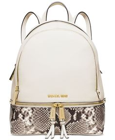 Tuck your tablet, makeup bag and other must-have items into this chicly organized backpack from Michael Michael Kors, designed in soft Venus leather with glamorous python embossing and bright hardware