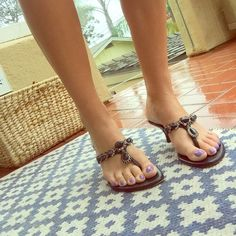 Stuart Weitzman Sandal Beautiful black Stewart Weitzman sandal with beading detail. Beading is in great condition, gently worn! Heel measures 2 1/2 inches. #sandals #shoes #heels #stewartweitzman #black #beaded #sandal #designer #summer Stewart Weitzman  Shoes