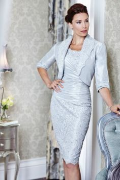 A two piece mother of the bride dress with elbow length sleeves. The soft bluish platinum grey colored suit dress could be modified by us when being made to order. The #motherofthebride dresses from our firm are all custom and can be made with any modification you need.  Get pricing on designs (from our site or from any where on the internet) from us at www.dariuscordell.com