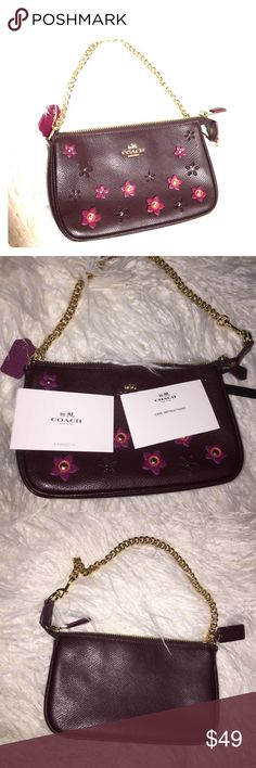 Coach Cute little Flower patches Wristlets handbag Hard to find piece, cross Grain leather with beautiful flower handcraft flowers attached, smooth zipper open with enough room for your iPhone , credit Card , keys and lipstick! Burgundy color can match your lips and nail polish! Must have !  Slightly used and like new ! Coach Bags Clutches & Wristlets