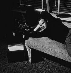 Marlon Brando listening to music at home.