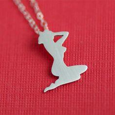 Pinup Necklace http://www.etsy.com/listing/61460270/1950s-pin-up-girl-silhouette-necklace-in