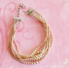 I love these multi strand pearl necklaces