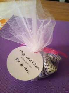 Wedding favor- hugs and kisses (but in the little brown boxes) Heard father of the bride wants candy, yum!