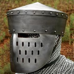 Our kalota with face guard is a handsome example of the continuous development and improvement of helmets in the Middle Ages. This kalota replica (type of early great helm) with a menacing face guard provides much more protection than a simple bowl with a Medieval Helmets, Medieval Weapons, Medieval Knight, Knight In Shining Armor, Knight Armor, Crusader Helmet, Armor Clothing, Medieval Clothing, Helmets For Sale