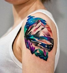 If you're tired of a white and black tattoo, you can also have this vividly colored mountain range tattoo signifying a colorful but arduous journey. Or you cna simply get it because of its charm.