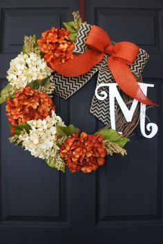 Grace your front door this Fall with this beautiful monogram grapevine wreath decorated with a lush Hydrangea blooms in burnt orange & antique white perfectly accented by fall leaves & foliage complemented by a large overlapping black & natural chevron chevron & orange burlap bow. Base Wreath Specifications: • Wreath base is 18 inches. You can choose to upgrade your wreath to a larger 20, 24 or 30   ❤ Personalize your wreath with a monogram of your choice (optional). • Script monogram is 12…