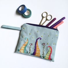 A funny zipper pouch with a creepy garden with full of weird plants on it and sewn with lots of love!    Evil eye plants and some octopus arm