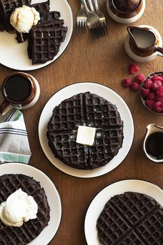 Dark Chocolate Zucchini Cake Waffles are the perfect combination of dessert and breakfast. Dark chocolate zucchini batter made into fluffy waffles!