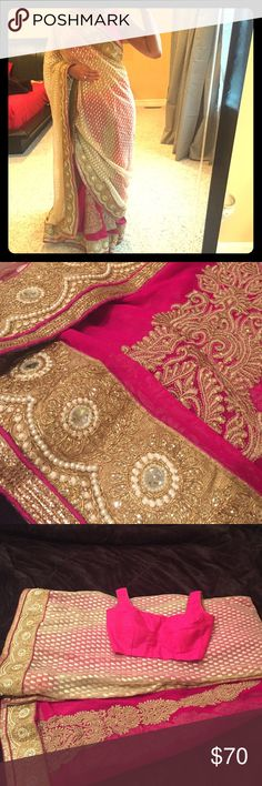 Indian saree Beautiful Bollywood style Indian saree. Pink and cream with gold embroidery. Beautiful border all around the saree. Chic blouse - deep U neck at the back (last picture). The blouse can be altered to make it bigger or smaller as it is hemmed. Comes with underskirt. Other