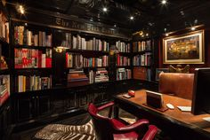 Tommy Hilfiger's dimly-lit library, with a zebra hide rug and red leather chairs to lend an air of handsome luxury.