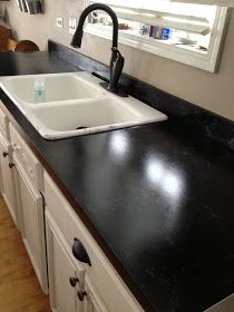 DIY: Countertop Makeover Tutorial - this blogger takes the intimidation out of refacing laminate. This is a great way to update your kitchen for very little $$$! Awesome DIY!