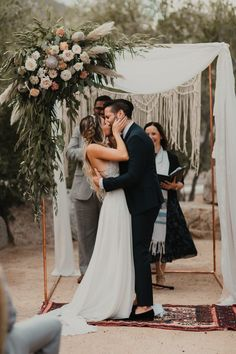 First kiss moment from this dreamy boho California wedding | Image by Cody and Allison Photography #wedding #weddinginspiration #californiawedding #retrowedding #desertwedding #bride #bridalstyle #bridalinspiration #groom #groominspiration #groomstyle #weddingportrait #coupleportrait #ceremony #weddinceremony #weddinfloraldesign #ceremonyarch #weddingdecor