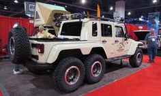 tandem axles are going mainstream! A four door wrangler with duals at SEMA