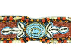 Lot 2 in the 9.3.13 Auction! Vintage African Kuba style beaded belt. Intricate detailing, the entire surface is lavishly adorned w/ colorful glass beads & cowrie shells in rows sewn onto a cloth backing. This was a sign of wealth in the Kuba Kingdom located in the Democratic Republic of the Congo; they used to use Cowrie shells as currency – the more you had the wealthier you appeared. There is an oval shaped medallion w/ turquoise inlay. #jewelry #fashion #clothing #POGAuctions