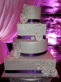 White & purple wedding cake, beautiful! Just enough glitz & sparkle mixed in with the elegance of the flowers. #Wedding #Purple #Purple Wedding #Wedding Ideas #Wedding Dresses