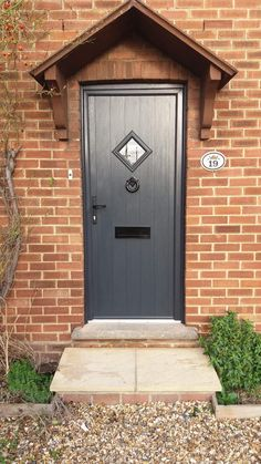 Composite door Prices & Why they are better than cheap front doors? Cottage Front Doors, Front Door Porch, Porch Doors, Cottage Door, Front Door Entrance, House Front Door, Best Front Doors, Black Front Doors, Back Doors