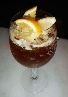 Cobbler Noir: Rabarbaro Zucca Amaro, Cocchi Americano, Maraschino Liqueur, Lemon Juice, Lemon Slices, Orange Slices.