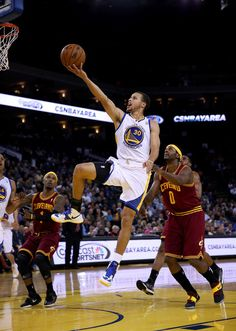 Stephen Curry #30 of the Golden State Warriors drives on C.J. Miles #0 of the Cleveland Cavaliers during their game at Oracle Arena on November 7, 2012 in Oakland, California.