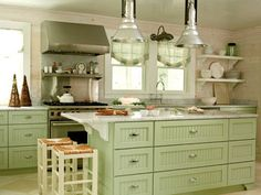 I love the pine board walls. I think I might get sick of the green cabinets, but they would match my Kitchen Aid stand mixer.