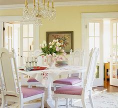 Yellow, white and lavender.  Not my fave, but I could imagine that seafoam blue on the walls.  I do love yellow though, and will be adding that color to my dinning room wall.  That with a soft light tan in the living room with all the mint blue accents etc will be very french country.  That style goes perfect for the seaside cottage look!!!