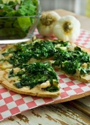 Spinach adds a little green to this white #pizza. Eat this tasty #spinach pizza for a delicious light lunch. For more, visit www.samc.com/healthy-recipes.