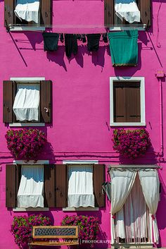 Beautiful pink house in Burano, Italy. Shop our beachwear collection at matthewwilliamson.com